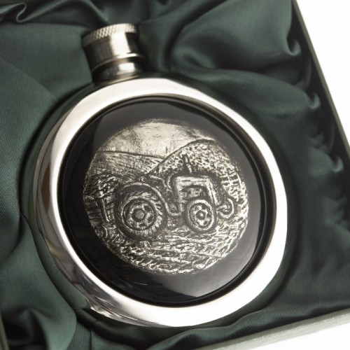Close-up of the Tractor Design on the Whiskey Flask