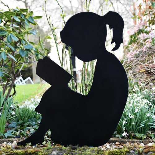 Metal Girl Reading Silhouette in situ in The Garden