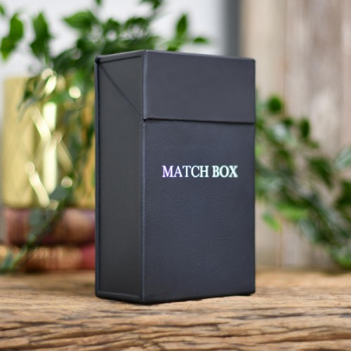 Black Match stick box on table