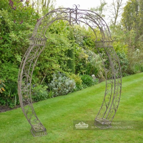 Ornate rustic brown garden rose arch