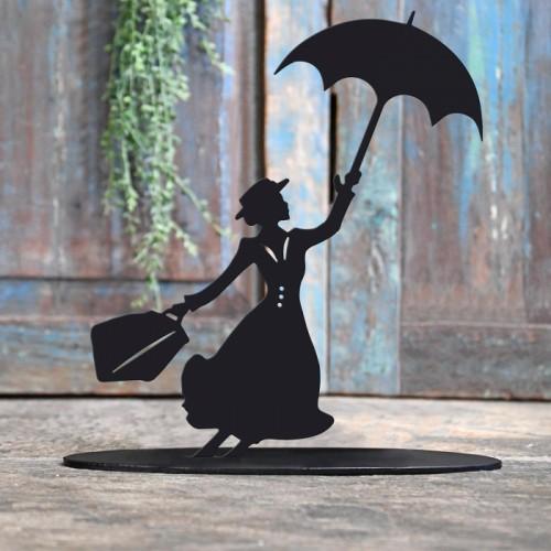 Mary Poppins Iron Door Stop Next to a Rustic Blue Door