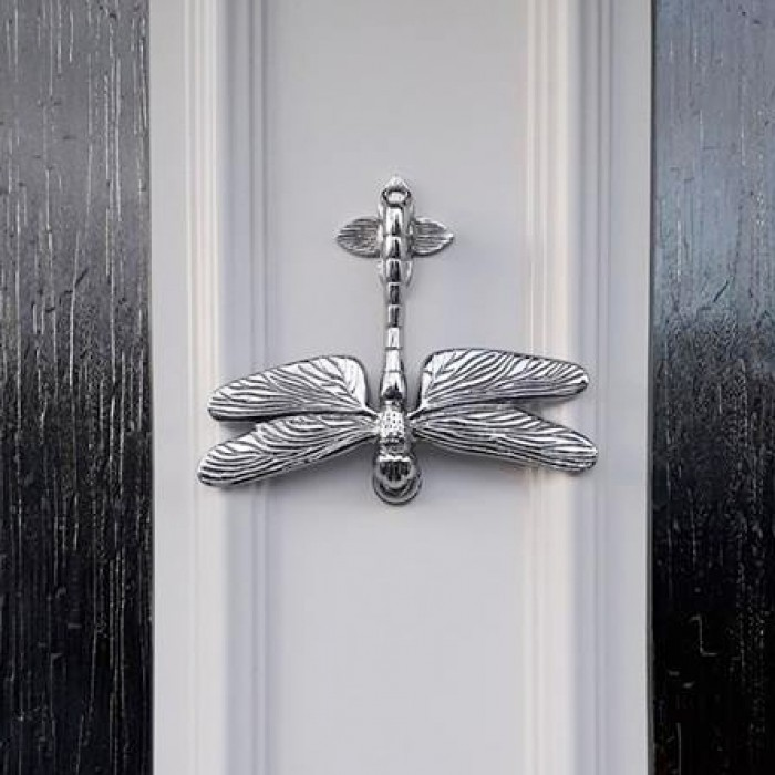 ... Bright Chrome Dragon Fly Door Knocker On White Door