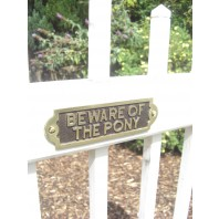 Beware of the Pony Gate Sign