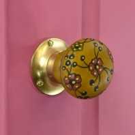 Brown and Red Flower Contemporary Polished Brass Door Knobs