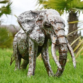 Recycled Metal Elephant with Trunk Up in Situ in the Garden