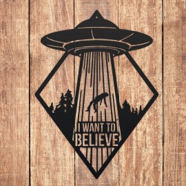 """""""I Want to Believe"""" Alien Wall Art in Situ on a Wooden Wall"""