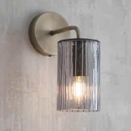 Antique Brass Ridged Glass Wall Light in Situ in a Rustic Wall