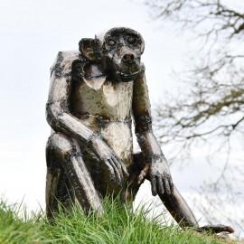 Baboon Sitting Slumped Garden Sculpture in Situ
