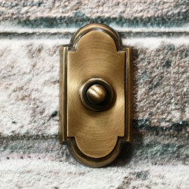 Antique Bronze Bell Push with arch on brick wall