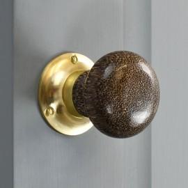 Leopard Print door knob with brass back plate on grey door