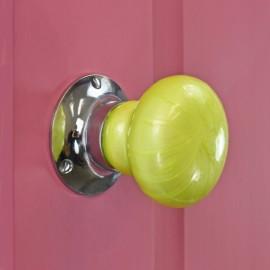 Lime Green Ceramic Door Knob on a Pink Door