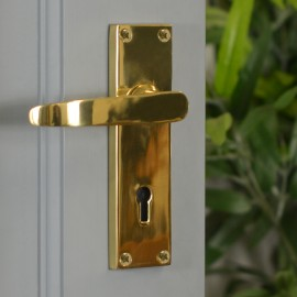 Polished Brass Lever Handle With Key Hole on Grey Door