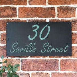 """Pastel Turquoise """"Saville"""" House Sign in Situ on the Wall"""