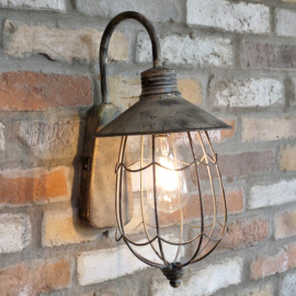 Caged wall light in a rustic finish