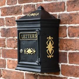Traditional postal box on brick wall