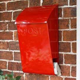 Modern post box on brick wall