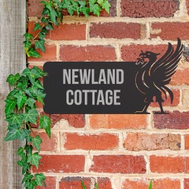 Liver Bird Iron House Name Sign in Use on a Brick Wall