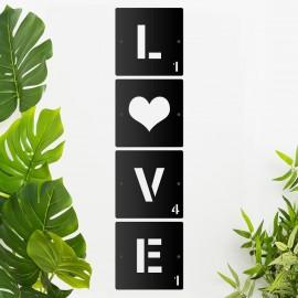 'LOVE' Scrabble Square Letters on a Cream Wall