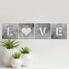 'LOVE' Scrabble Square Letters in Situ Next to Plants
