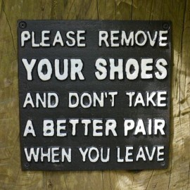 """""""Please Remove Your Shoes And Don't Take A Better Pair When You Leave"""" Cast Iron Sign in Black with White Text"""