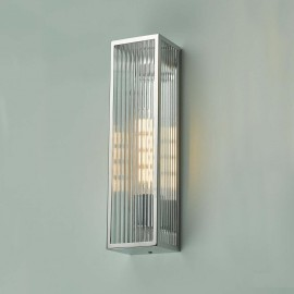 Polished Stainless Steel Reeded Glass Wall Light in Situ on a Green Wall