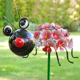 Smiling Lady Bird Spike With Flower Design Back
