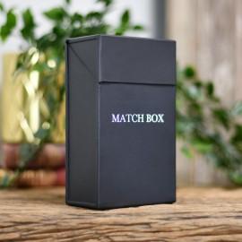 Black Match stick box on table