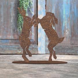 Boxing Hares Rustic Iron Door Stop in Front of a Rustic Blue Door