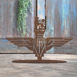 British Parachute Regiment Rustic Iron Door Stop in Front of a Rustic Blue Door