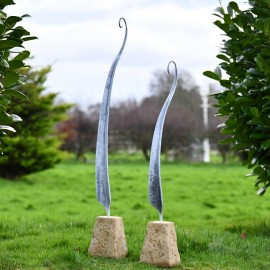 Fern Sculptures Finished in a Rustic Steel in Situ in the Garden