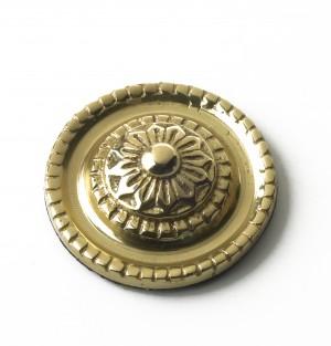 polished brass ornate motif