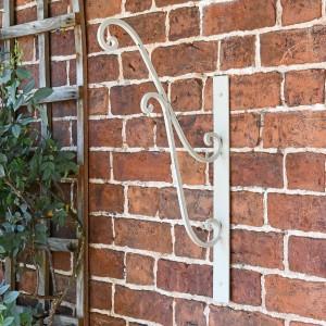 'Turenne' Rustic Cream Hanging Basket Bracket on a Brick Wall