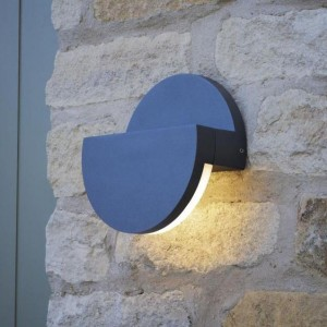 Adjustable Circle Wall Light in Use on a Stone Wall