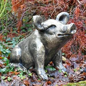 Antique Gold Sitting Pig Sculpture in Situ in the garden