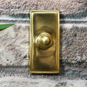 Polished Brass Finish rectangle door Button on brick wall