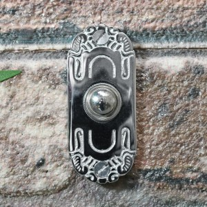 Beautiful art Nouveau inspired door bell on brick wall