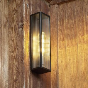 Bronze Reeded Glass Wall Light in Situ on a Wooden Wall