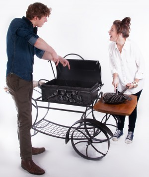 Barbeque with two wooden worktops with wheels