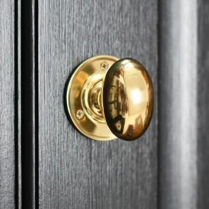 Oval door knob on black door