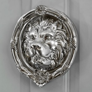 Bright Chrome Sandringham door knocker on grey door