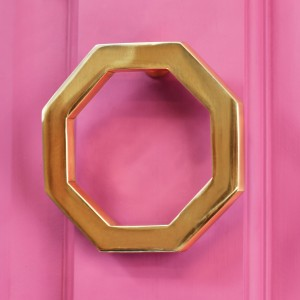 Polished brass Octagonal door knocker on pink door