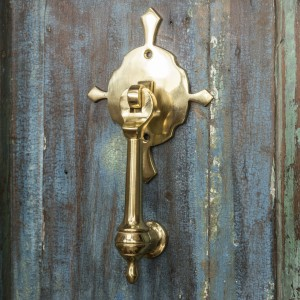 Polished Brass Turnbrook Park door knocker on Old Wooden Door