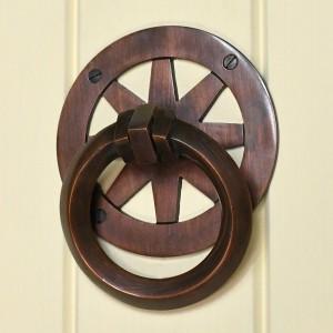 Contemporary round door knocker on cream door