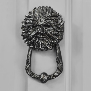 Green Man door knocker finished in black on grey door