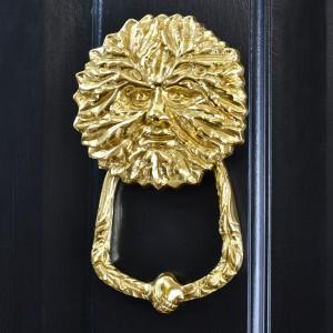 Polished Brass Green man door knocker on black door