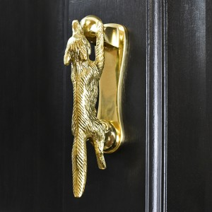 Polished Brass Running Fox Door knocker on black wood door