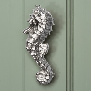 Bright Chrome Sea Horse Door Knocker on pale Green door