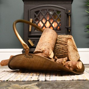 Antique log holder in living room infront of fire