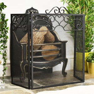 Black Three fold Fire screen in living room