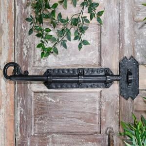 Grimoire Door Bolt in Situ on a rustic Wooden Door